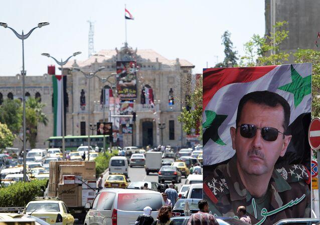 Retrato do presidente sírio Bashar Assad nas ruas de Damasco, Síria