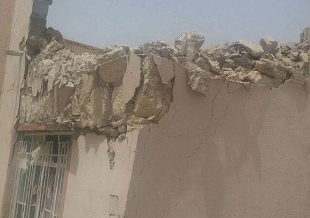 Inferno no Iraque: prédios destruídos por foguetes Jhannam, de fabrico terrorista, na cidade de el-Khaldiya, na província de Anbar, em 16 de maio de 2016
