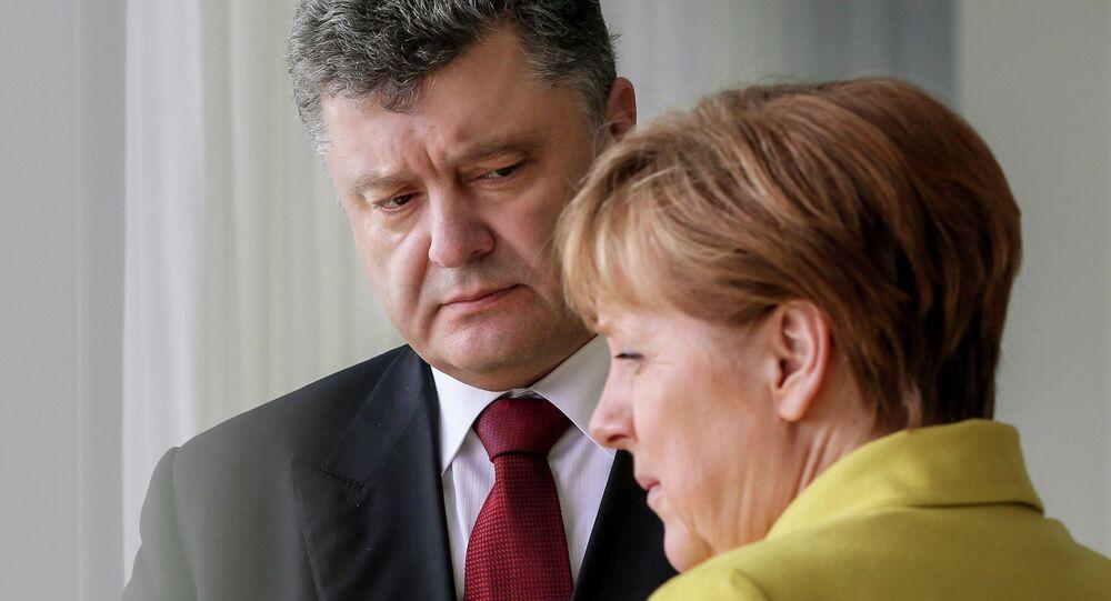 Pyotr Poroshenko e Angela Merkel