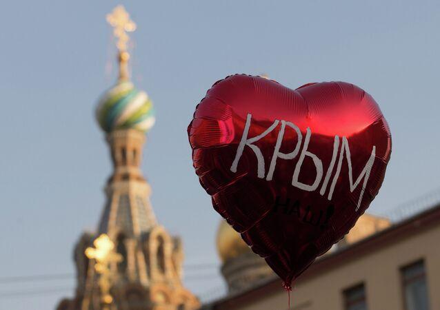 Comemoração do primeiro aniversário de reunificação da Crimeia com a Rússia em São Petersburgo