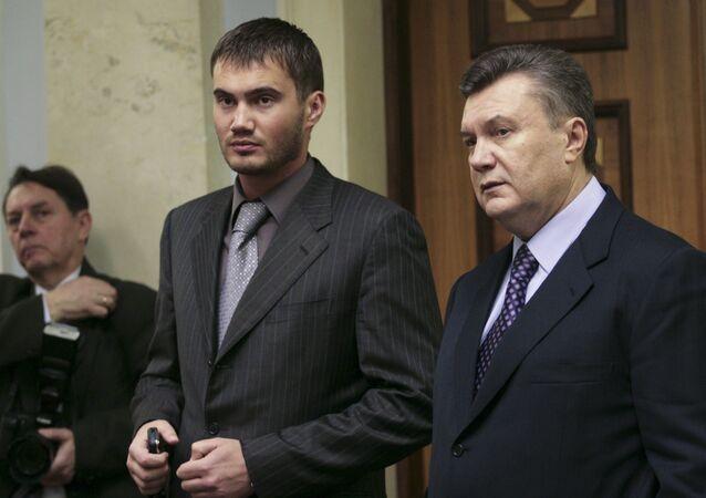 Ex-presidente da Ucrânia Viktor Yanukovych com filho