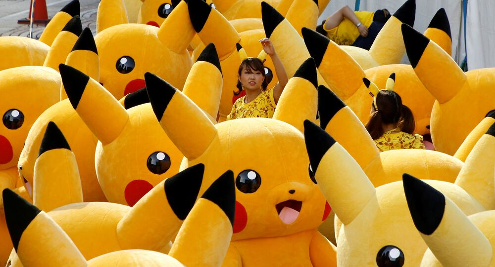A staff guides performers wearing Pokemon's character Pikachu costumes as they prepare for a parade in Yokohama, Japan