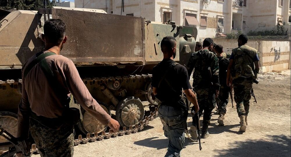 Militares do exército sírio durante ataques contra colégios militares em Aleppo, 17 de agosto de 2016