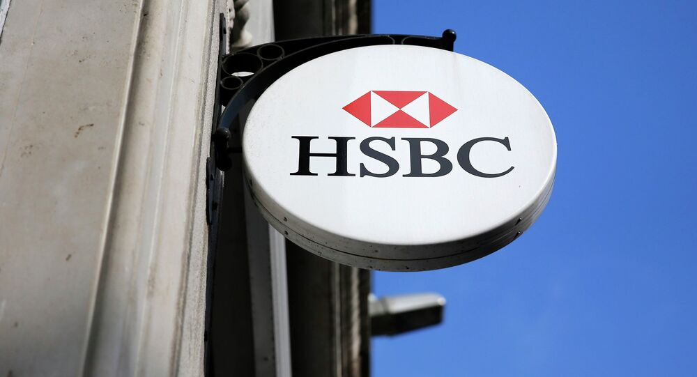 An HSBC sign is seen outside a bank branch in London February 9, 2015
