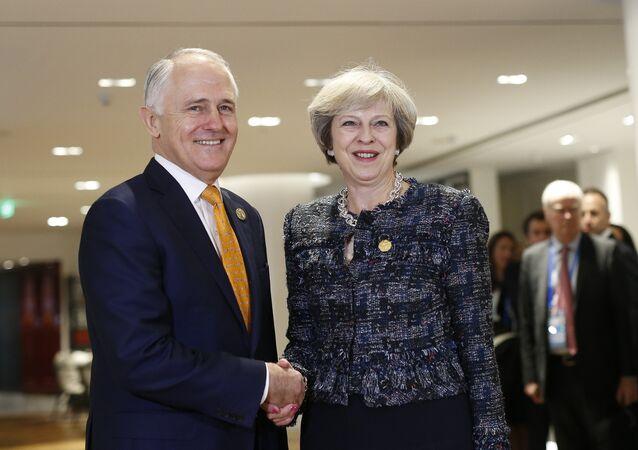 Malcolm Turnbull e Theresa May em encontro na cidade de Hangzhou, na China