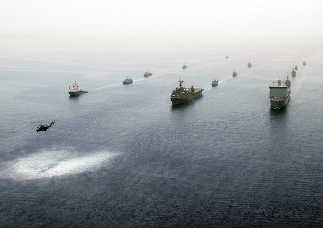 Multinational ships are underway in formation in the Persian Gulf May 21, 2013, during International Mine Countermeasures Exercise.