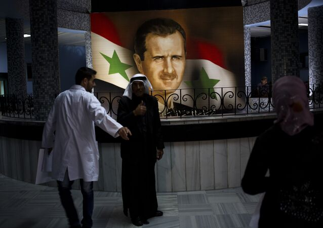 Retrato de Assad no hospital de Damasco,4 de maio de 2014