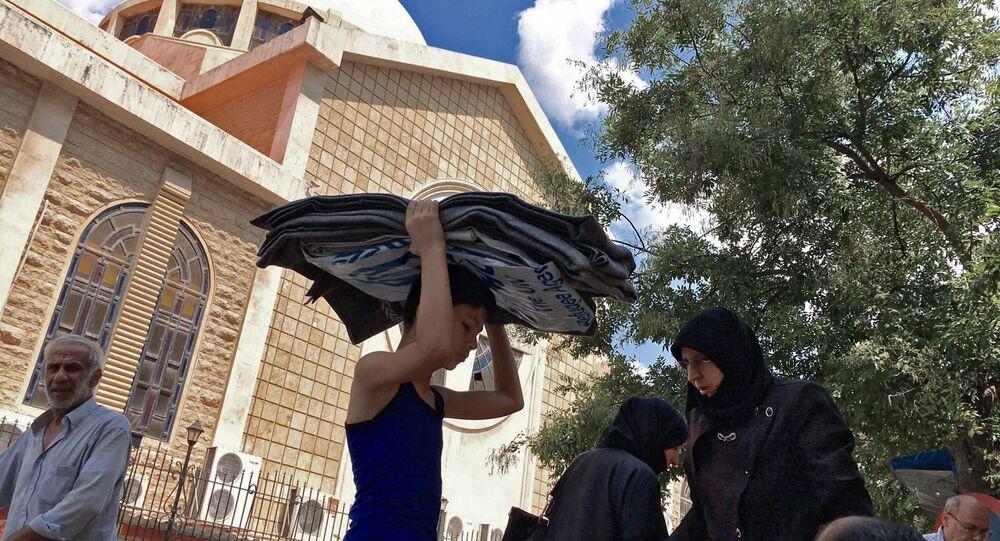Refugiados do bairro 1070, no sudoeste de Aleppo (Arquivo)