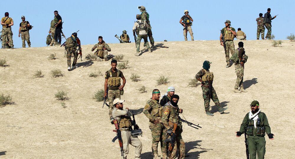Combatentes xiitas avançam em direção de Salmani, a sul de Mossul, Iraque, 30 de outubro de 2016