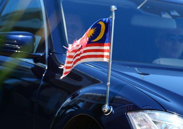 Primeiro-ministro malaio Najib Razak chega ao Radisson Blu Resort & Congress para participar das negociações
