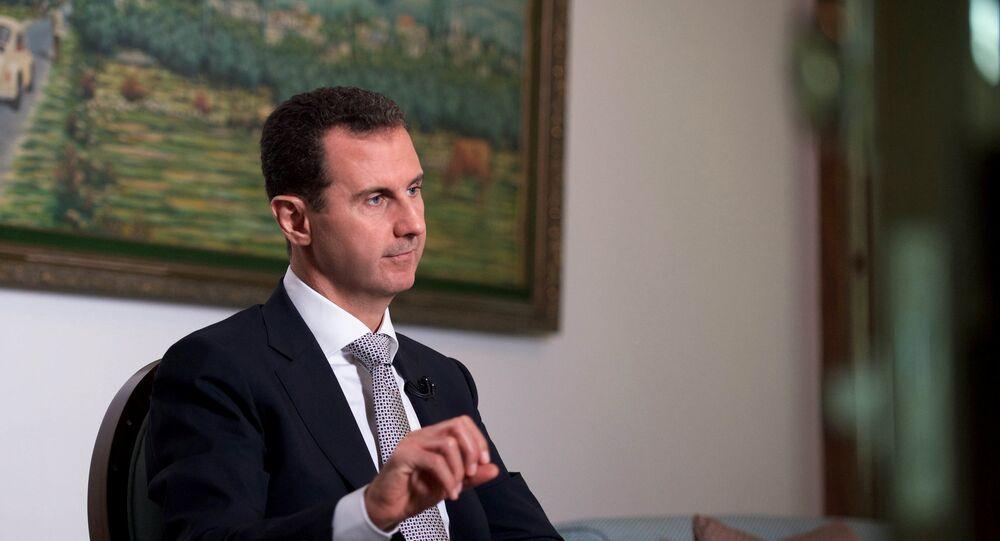 Presidente da Síria, Bashar Assad, faz um discurso durante uma entrevista com uma agência de notícias cubana