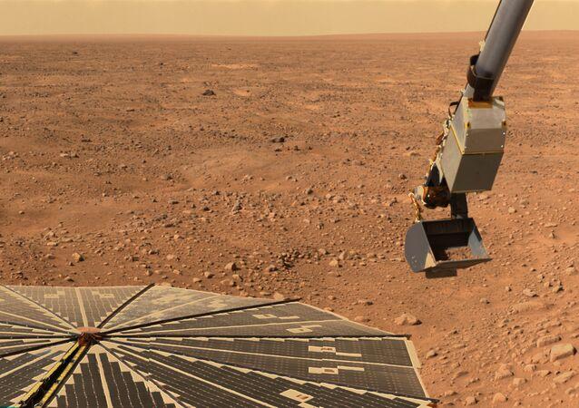 Uma sonda da NASA recolhendo amostras do solo marciano para a pesquisa
