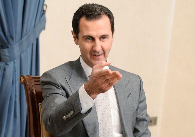 Presidente da Síria, Bashar Assad, visto durante uma visita do vice-primeiro-ministro russo, Dmitry Rogozin, a Damasco