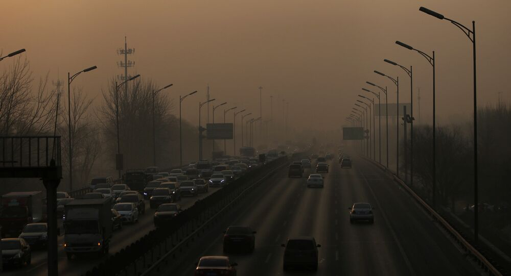 Vehicles drive on the 5th Ring Road in smog during morning rush hour on the fourth day after a red alert was issued for heavy air pollution in Beijing, China, December 19, 2016.