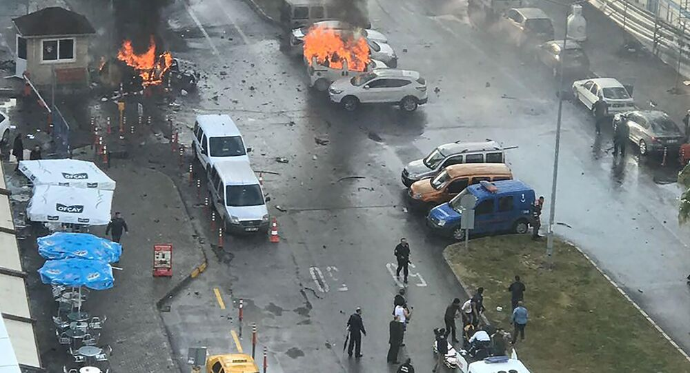 Cars burn in the street at the site of an explosion in front of the courthouse in Izmir on January 5, 2017