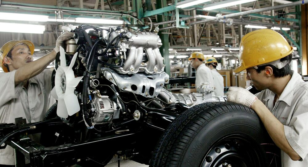Workers assemble a vehicle at a Toyota motor plant in Vinh Phuc (File)