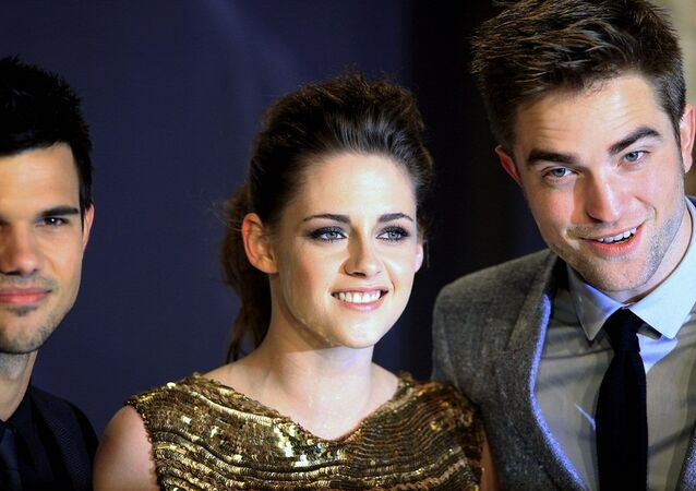 Taylor Lautner, Kristen Stewart e Robert Pattinson, estrelas da série de filmes Crepúsculo