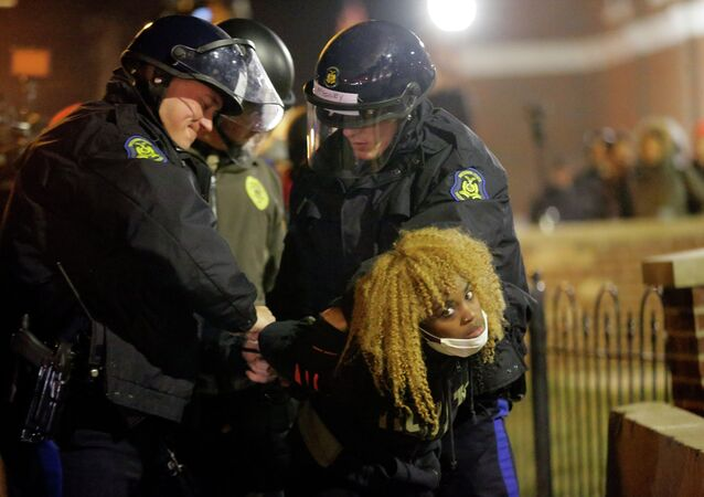 Police officers take a protester into custody Tuesday, Nov. 25, 2014, in Ferguson