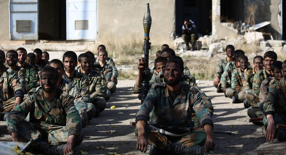 Syrian youths take part in their last training on December 8, 2014 before being sent to the frontline along with rebel fighters from the Jaysh al-Islam brigades (Army of Islam) in Eastern al-Ghouta, a rebel-held region outside the capital Damascus