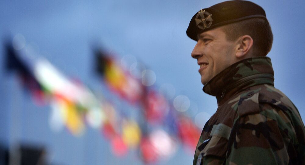 A Latvian soldier stands guard in front the Summit Hall in Riga, Latvia