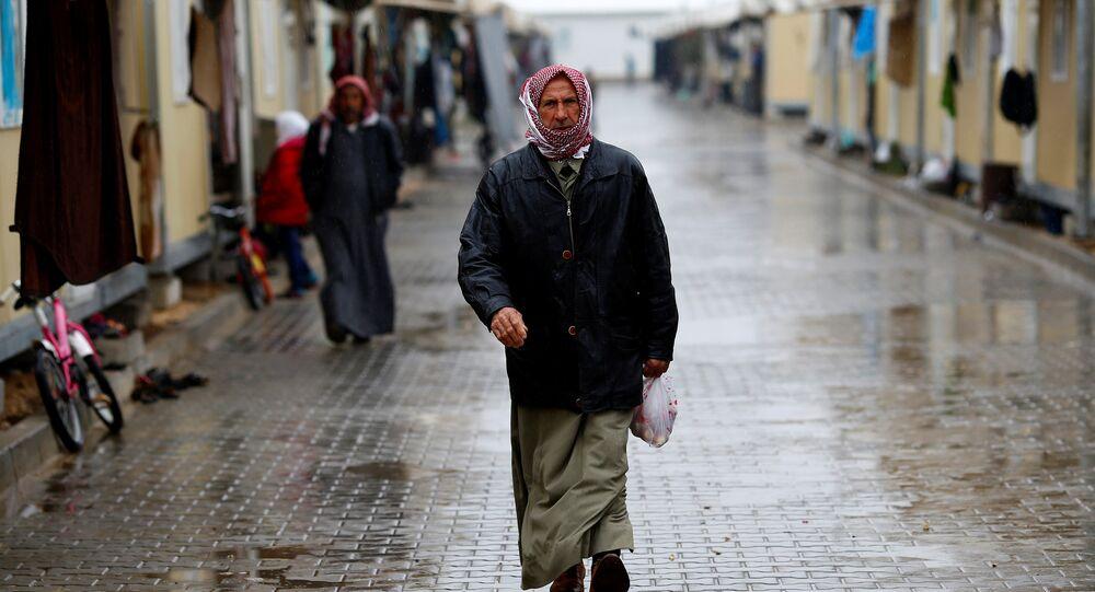 A Syrian refugee man walks in Elbeyli refugee camp near the Turkish-Syrian border in Kilis province, Turkey, December 1, 2016