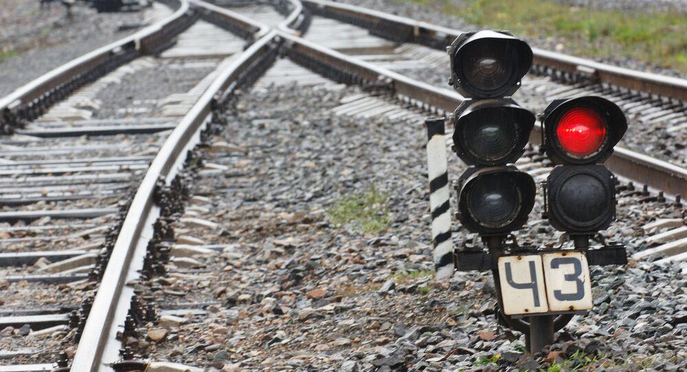 Sinal vermelho em ferrovia