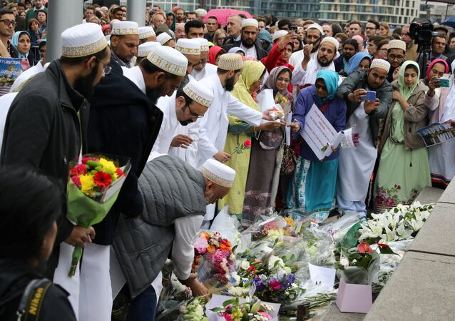 People lay flowers after a vigil to remember the victims of the attack on London Bridge and Borough Market, at Potters Field Park, in central London, Britain, June 5, 2017.