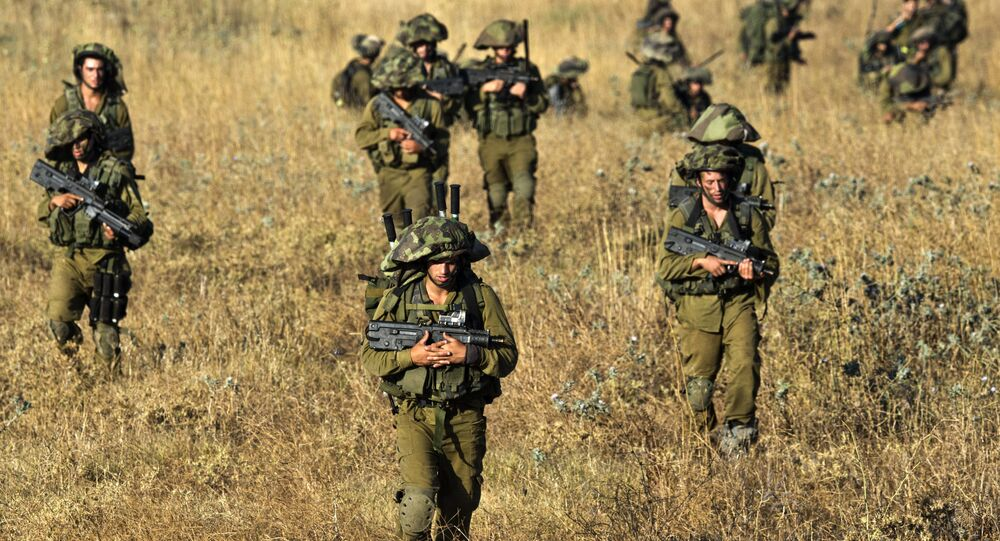 Israeli soldiers from the Golani Brigade take part in a military exercise in the Israeli-annexed Golan Heights near the border with Syria on June 26, 2013