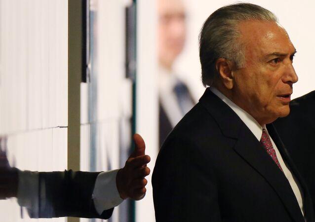 Michel Temer chega a uma cerimônia no Planalto, em 27 de julho de 2017