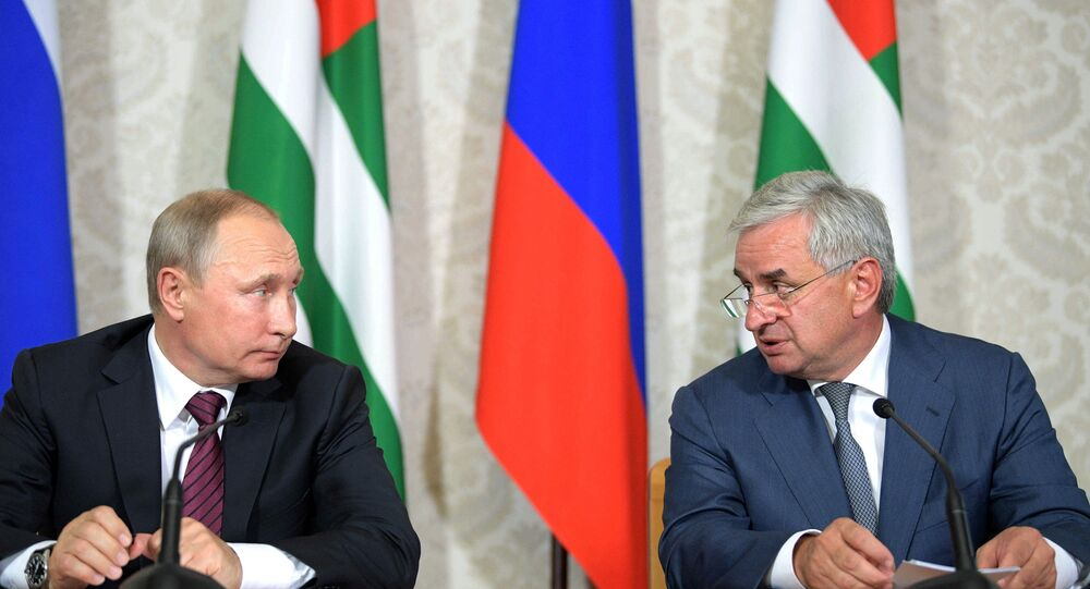 President Vladimir Putin and President of Abkhazia Raul Khadjimba, right, during a news conference following talks, August 8, 2017.
