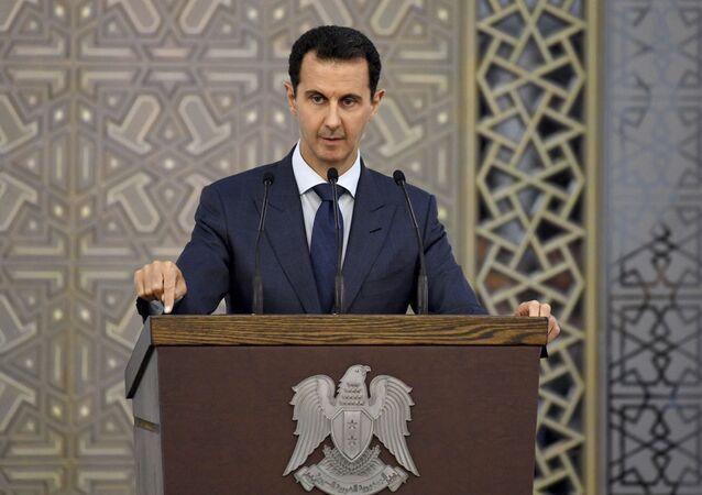 O presidente sírio Bashar Assad durante um discurso em frente dos diplomatas, em 20 de agosto de 2017