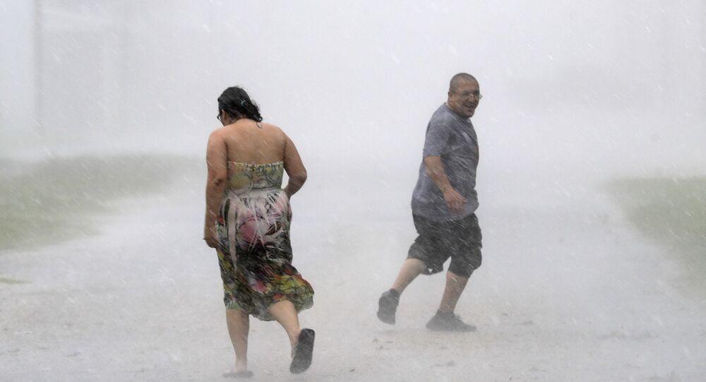 Texans run through the street during a band of heavy rain from Hurricane Harvey Saturday, Aug. 26, 2017, in Palacios, Texas.
