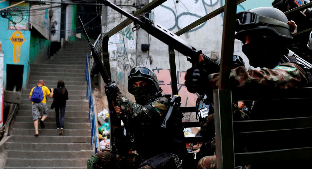 Armed Forces take up position during a operation after violent clashes between drug gangs