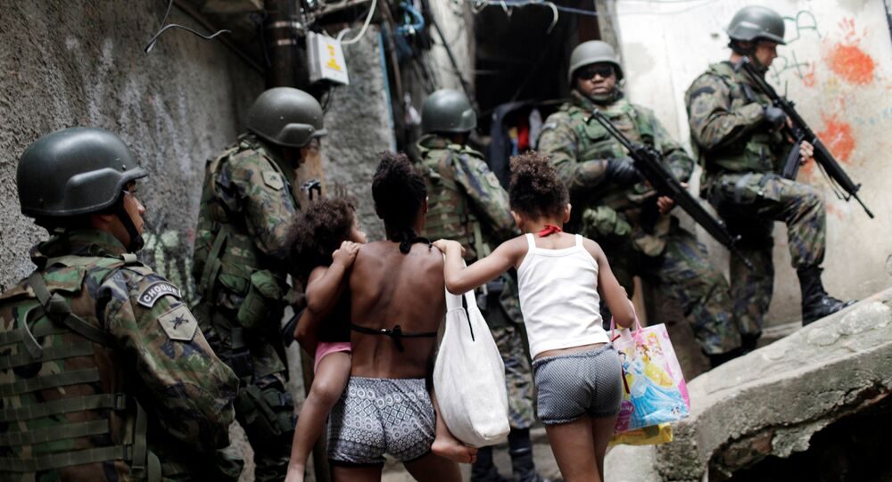 Armed Forces take up position during a operation after violent clashes between drug gangs in Rocinha slum in Rio de Janeiro, Brazil