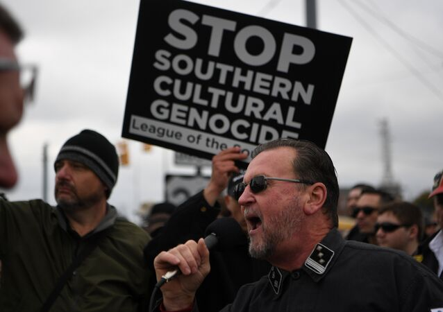 A protester shouts into the microphone during a White Lives Matter rally in Shelbyville, Tennessee, U.S., October 28, 2017.