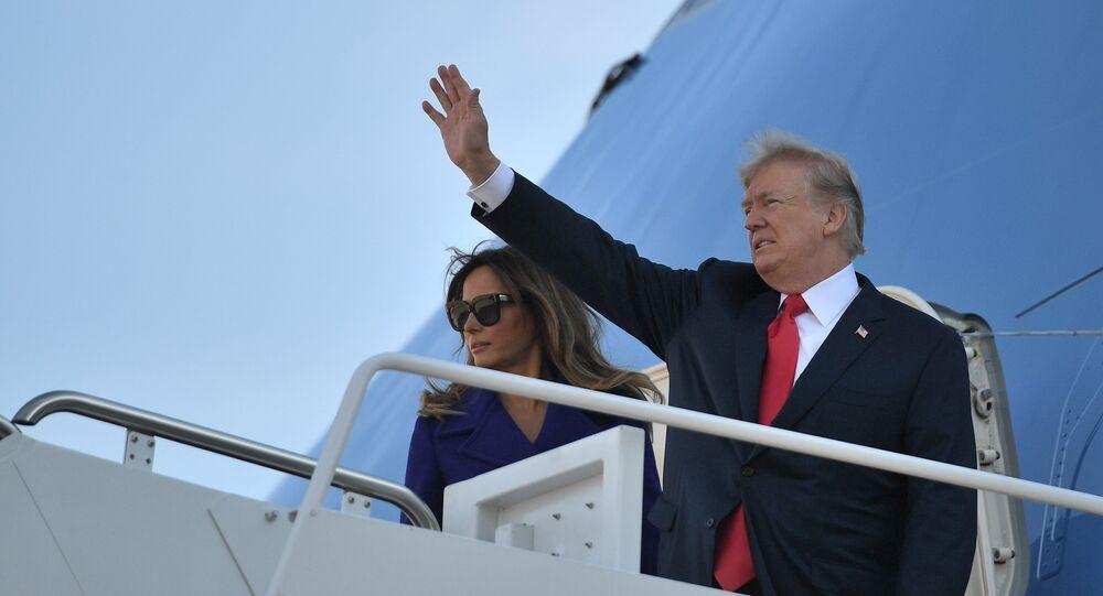 Presidente norte-americano Donald Trump e a sua mulher Melania Trump partindo de Maryland em 3 de novembro para uma digressão de 11 dias pela Ásia