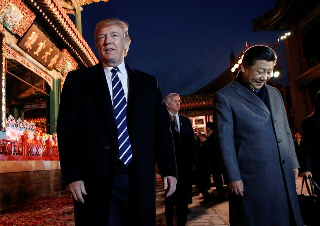US President Donald Trump and China's President Xi Jinping leave after an opera performance at the Forbidden City in Beijing, China, November 8, 2017.