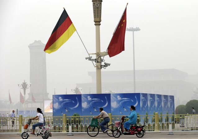German and Chinese national flags are attached to a lamp post on Tiananmen Square (File)